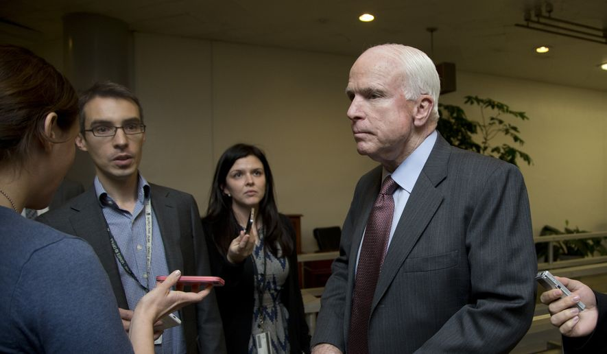 Sen. John McCain, R-Ariz., listens to questions from reporters on Capitol Hill in Washington, Friday, Dec. 12, 2014. (AP Photo/Manuel Balce Ceneta) ** FILE **