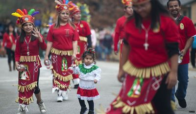 Abigail Ramirez, 1, center, dances in the middle of the Danza Guadalupana dance group in the annual St. Peter Claver Parish Virgen de Guadeloupe parade in Tyler, Texas. Virgen de Guadalupe, also known as Our Lady of Guadeloupe, is the patron saint of Mexico. Catholics around the world celebrate Virgen de Guadeloupe each year on Dec. 12. It is said that in 1531, an image of the Virgin Mary, a young woman surrounded by light, appeared to an indigenous peasant named Juan Diego outside of Mexico City. (AP Photo/The Tyler Morning Telegraph, Sarah A. Miller)