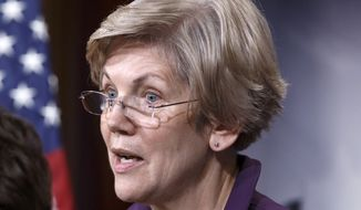 In this Dec. 10, 2014, file photo, Sen. Elizabeth Warren, D-Mass., speaks on Capitol Hill in Washington. More than 300 former campaign staffers and organizers for President Barack Obama have signed on to a letter urging Warren to run for president in 2016. (AP Photo/J. Scott Applewhite, File)