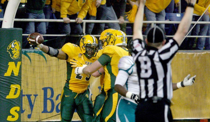 North Dakota State's John Crockett, left, celebrates his first half touchdown against Coastal Carolina during an FCS quarterfinal NCAA college football game Saturday, Dec. 13, 2014, in Fargo, N.D.  (AP Photo/Bruce Crummy)