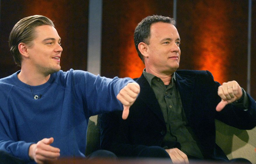 "FILE - The Jan. 25, 2003 file photo shows U.S. actors Leonardo DiCaprio, left, and Tom Hanks joking during German TV show 'Wetten, dass...?!' ('Bet It...?!') in Boeblingen near Stuttgart, southern Germany.   ""Wetten, dass...."" - Germany's most successful TV show - will be televised for the last time on Saturday, Dec. 13, 2014.  Since its start in 1981 the show has been a magnet for international entertainment stars and had more than 20 million viewers per show in the 1980s.  (AP Photo/Ralph Orlowski, pool)"