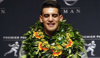 Oregon quarterback Marcus Mariota speaks during a news conference after being awarded the Heisman Trophy, Saturday, Dec. 13, 2014, in New York. (AP Photo/Julio Cortez)