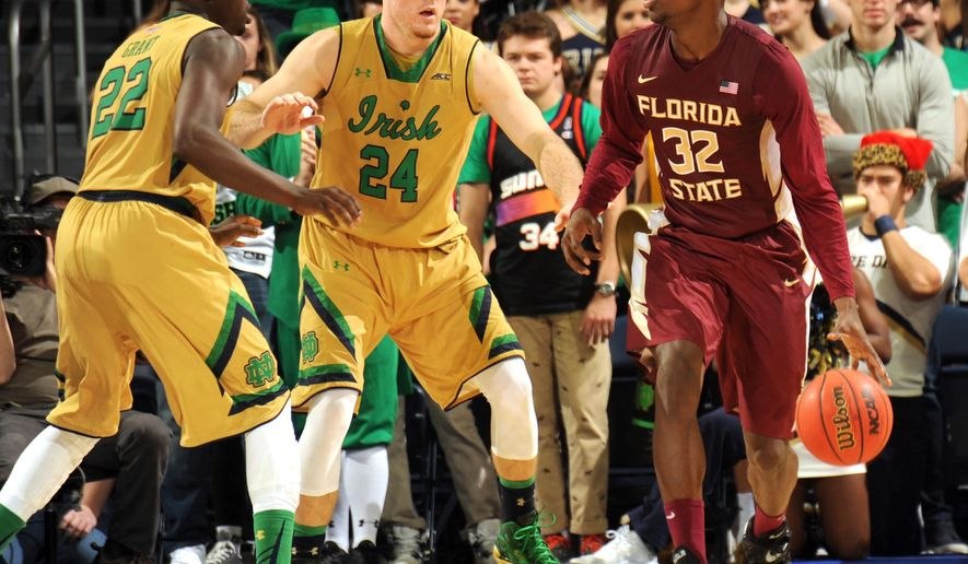 Florida State guard Montay Brandon, right, drives around Notre Dame guards Jerian Grant, left and Pat Connaughton in the second half of an NCAA basketball game Saturday, Dec., 13, 2014 in South Bend, Ind. Notre Dame won 83-63 with Brandon scoring 14 points. (AP Photo/Joe Raymond)