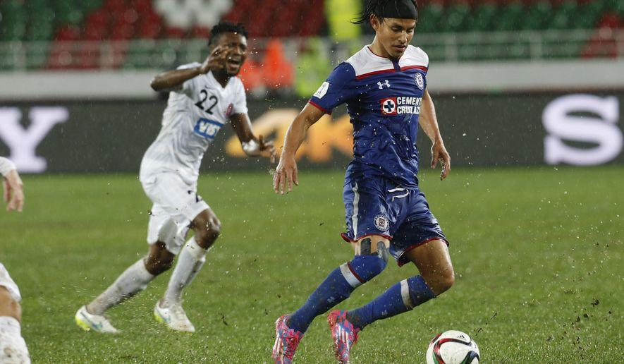 Cruz Azul's Gerardo Flores, left, and Western Sydney Wanderers' Seyi Adeleke during the soccer match between Cruz Azul and Western Sydney Wanderers at the Club World Cup soccer tournament in Rabat, Morocco, Saturday, Dec. 13, 2014. (AP Photo/Abdeljalil Bounhar)