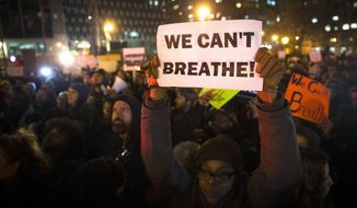 In this Dec. 4, 2014 file photo, demonstrators participate in a rally against a grand jury's decision not to indict the police officer involved in the death of Eric Garner, in New York. (AP Photo/John Minchillo, File)