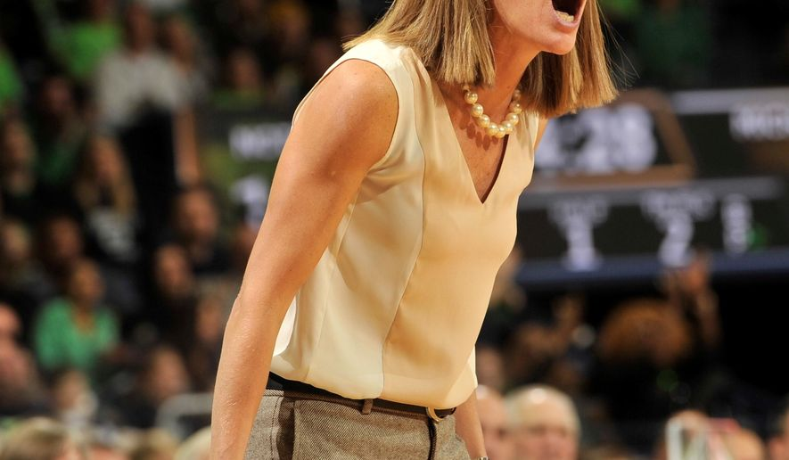 Michigan coach Kim Barnes Arico shouts instructions to her team in the first half of an NCAA basketball game against Notre Dame, Saturday, Dec. 13, 2014 in South Bend, Ind. (AP Photo/Joe Raymond)
