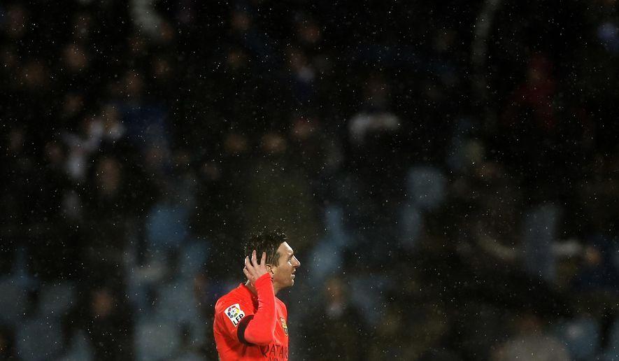 Barcelona's Lionel Messi reacts during a Spanish La Liga soccer match between Getafe and Barcelona a at the Coliseum Alfonso Perez stadium in Madrid, Spain, Saturday, Dec. 13, 2014. (AP Photo/Daniel Ochoa de Olza)