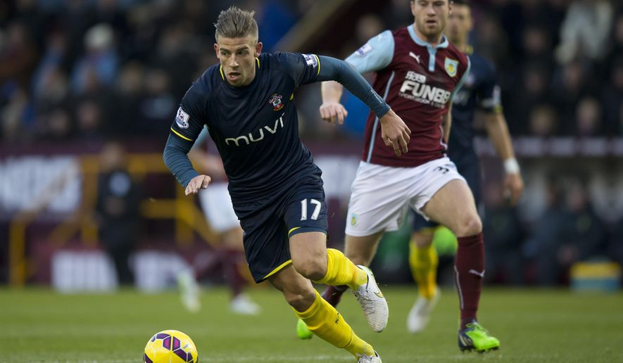 Southampton's Toby Alderweireld, left, keep the ball from Burnley's Ashley Barnes during the English Premier League soccer match between Burnley and Southampton at Turf Moor Stadium, Burnley, England, Saturday, Dec. 13, 2014. (AP Photo/Jon Super)