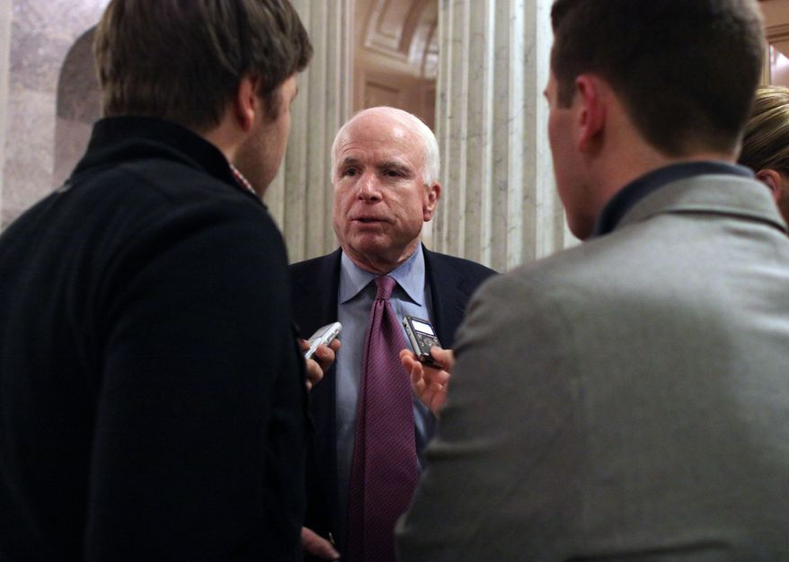 Sen. John McCain (R-AZ) talks with reporters after the Senate voted on a $1.1 trillion spending bill to fund the government through the next fiscal year on on Saturday, December 13, 2014 on Capitol Hill in Washington. (AP Photo/Lauren Victoria Burke)