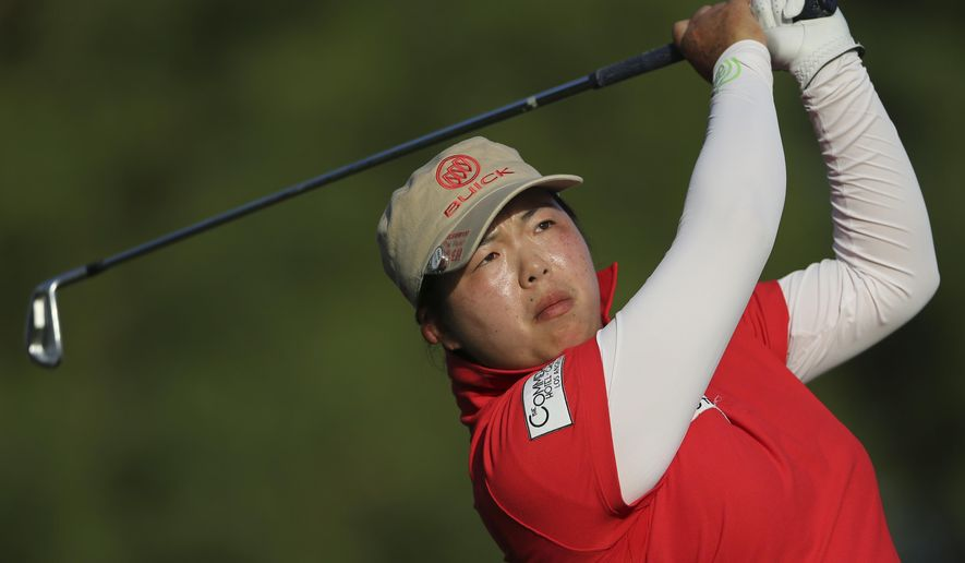 Shanshan Feng of China plays a ball on the 15th hole during final round of the Omega Dubai Ladies Masters in Dubai, United Arab Emirates, Saturday, Dec. 13, 2014. (AP Photo/Kamran Jebreili)