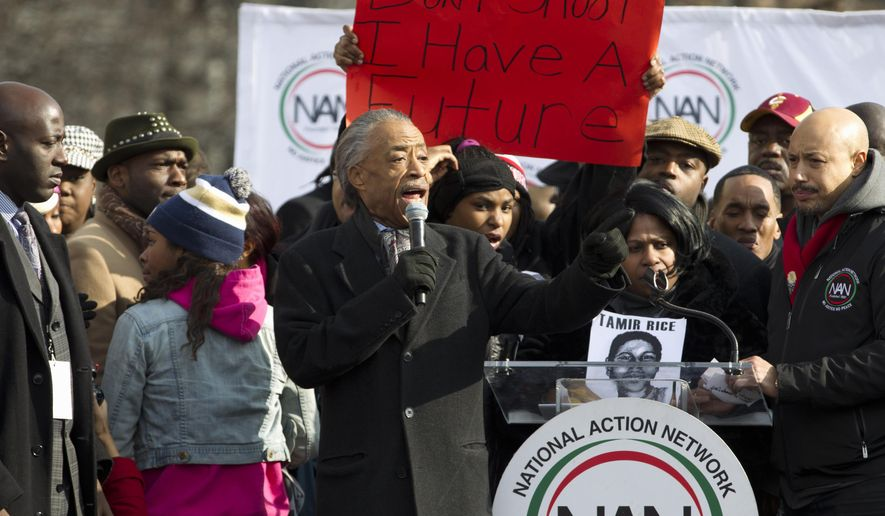 Rev. Al Sharpton speaks at Freedom plaza in Washington, Saturday, Dec. 13, 2014, during the Justice for All march and rally. More than 10,000 protesters are converging on Washington in an effort to bring attention to the deaths of unarmed black men at the hands of police. Civil rights organizations are holding a march to the Capitol on Saturday with the families of Michael Brown and Eric Garner, two unarmed black men who died in incidents with white police officers. (AP Photo/Jose Luis Magana)