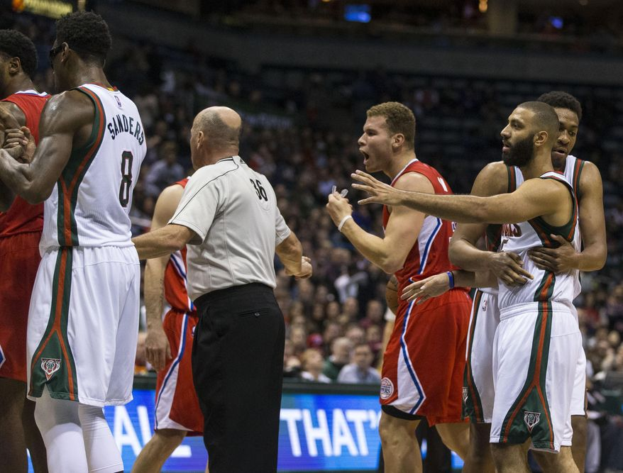 Los Angeles Clippers' Blake Griffin, third from right, reacts after getting involved in a loose ball struggle with the Milwaukee Bucks during the first half of an NBA basketball game Saturday, Dec. 13, 2014, in Milwaukee. (AP Photo/Tom Lynn)