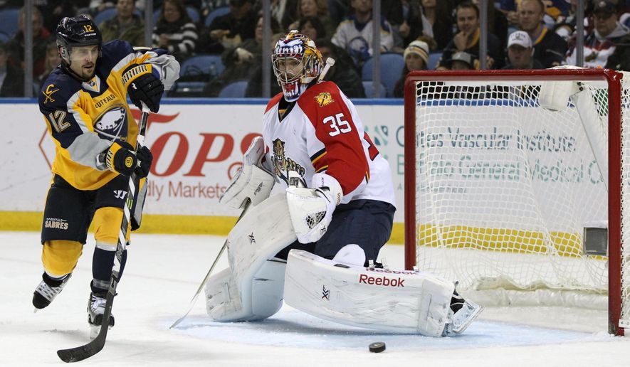 Buffalo Sabres right winger Brian Gionta (12) deflects the puck against Florida Panthers goaltender Al Montoya (35) during the first period of an NHL hockey game Saturday, Dec. 13, 2014, in Buffalo, N.Y. (AP Photo/Gary Wiepert)