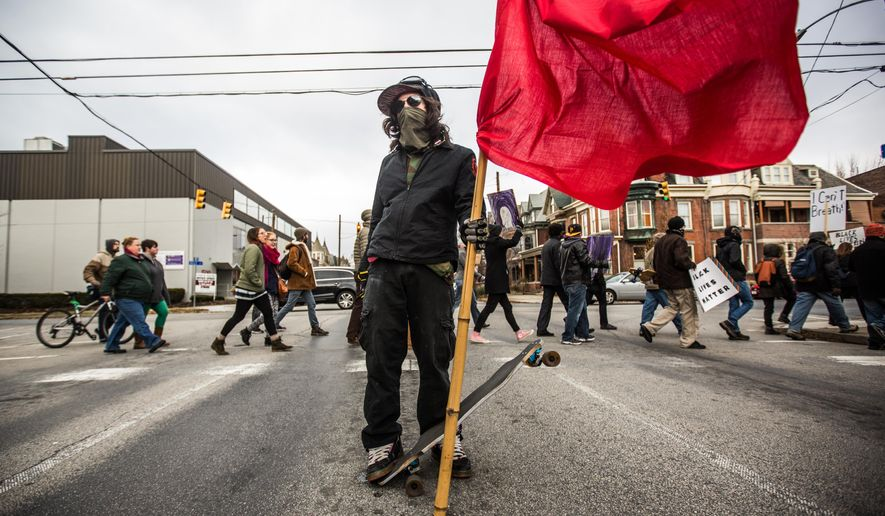 Protesters march from the Governors Mansion to the Pennsylvania State Capital Saturday  in Harrisburg, Saturday, Dec. 13, 2014,  in protest of police abuses in the black community. (AP Photo/PennLive.com, James Robinson)