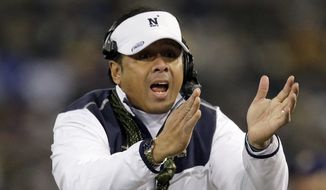 Navy head coach Ken Niumatalolo tries to get an official's attention in the second half of the Army-Navy NCAA college football game, Saturday, Dec. 13, 2014, in Baltimore. (AP Photo/Patrick Semansky)
