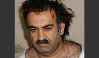 Khalid Sheikh Mohammed, shortly after his capture during a raid in Pakistan, is shown in this March 1, 2003, file photo. (AP Photo, File)
