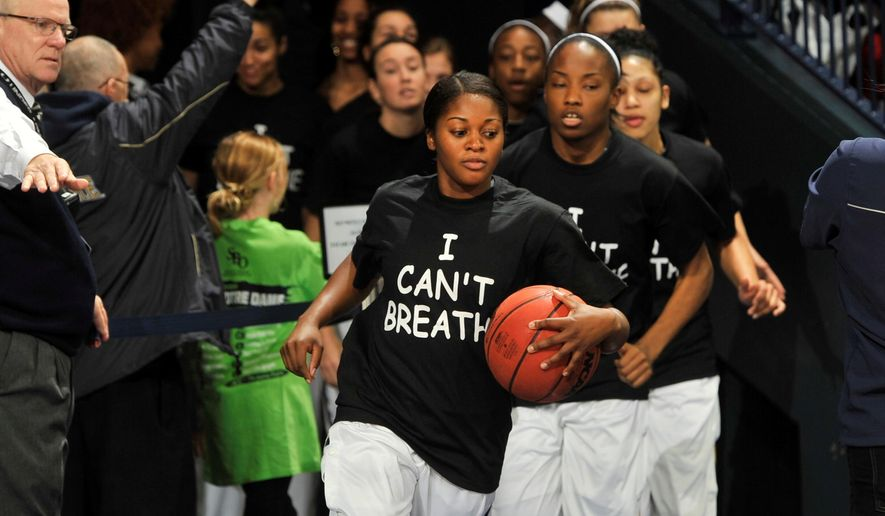 "Notre Dame players wears an ""I Can't Breathe"" shirts during warm-ups before an NCAA college basketball game against Michigan,  Saturday, Dec. 13, 2014 in South Bend, Ind.  (AP Photo/Joe Raymond)"