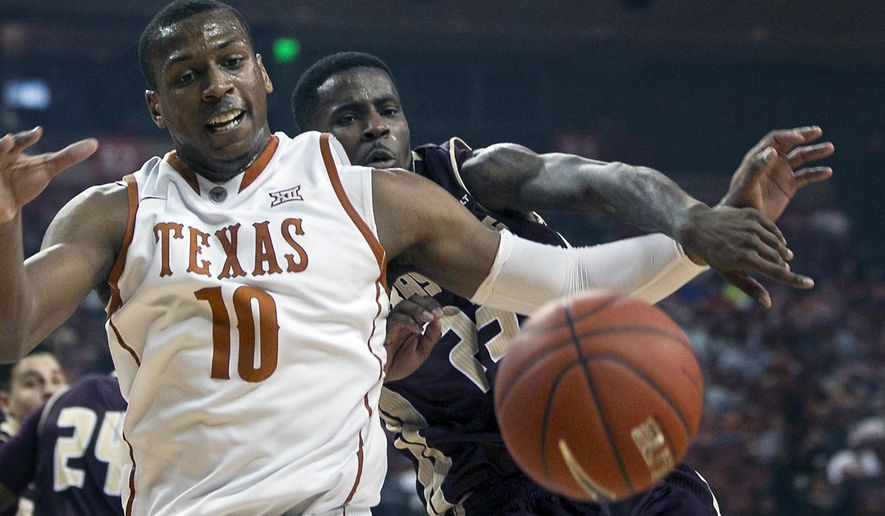 Texas Jonathan Holmes, (10) and Texas State JaMarcus Weatherspoon, right, battle for a loose ball during the first half of an NCAA college basketball game, Dec. 13, 2014, in Austin, Texas.  (AP Photo/Rodolfo Gonzalez)
