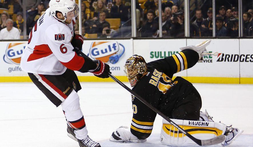 Ottawa Senators' Bobby Ryan scores the winning goal during a shootout on Boston Bruins goalie Tuukka Rask in the Senators 3-2 win in an NHL hockey game in Boston Saturday, Dec. 13, 2014. (AP Photo/Winslow Townson)