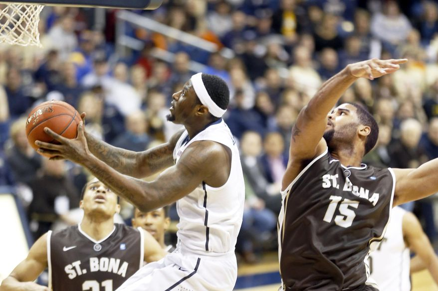 Pittsburgh's Jamel Artis, left, shoots after getting past St. Bonaventure's Chris Dees (15) in the first half of an NCAA college basketball game on Saturday, Dec. 13, 2014, in Pittsburgh. (AP Photo/Keith Srakocic)