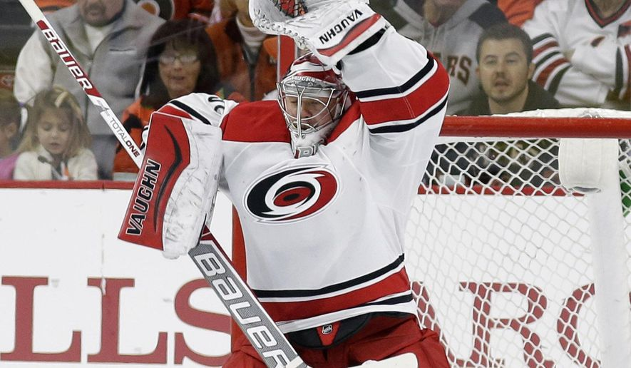 Carolina Hurricanes' Anton Khudobin, of Kazakstan, tries to block a wide shot during the first period of an NHL hockey game against the Philadelphia Flyers, Saturday, Dec. 13, 2014, in Philadelphia. (AP Photo/Matt Slocum)