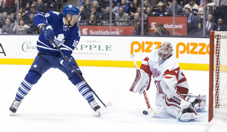 Toronto Maple Leafs' Richard Panik (18) scores his team's second goal on Detroit Red Wings goaltender Petr Mrazek during second period of an NHL hockey game in Toronto, Saturday, Dec. 13, 2014. (AP Photo/The Canadian Press, Chris Young)