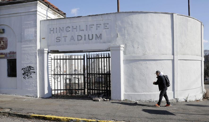 FILE - In this March 14, 2013, file photo, a man walks past an entrance to Hinchliffe Stadium in Paterson, N.J. The U.S. Senate approved a measure Friday, Dec. 12, 2104, that would add Hinchliffe Stadium to Great Falls National Historical Park in Paterson. The measure, one of several parks provisions attached to the defense bill, now heads to President Barack Obama's desk. (AP Photo/Mel Evans, File)