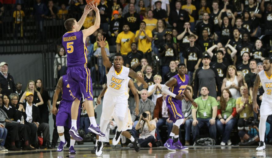 Northern Iowa's Matt Bohannon (5) launches another 3-pointer during the second overtime session of an NCAA college basketball game in VCU in Richmond, Va., Saturday, Dec. 13, 2014. VCU won 93-87 in double overtime.  (AP Photo/Skip Rowland)