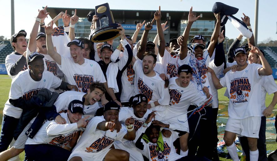 Virginia players celebrate following their 4-2 win over UCLA in the NCAA College Cup championship game. (Associated Press)