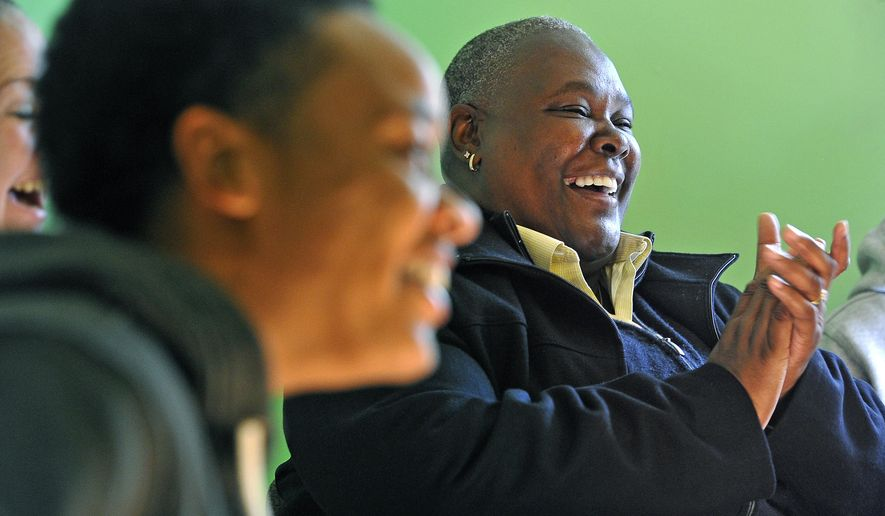 In this Tuesday Nov. 18, 2014 photo, Trina Frierson, executive director of Mending Hearts, laughs with members of a residential recovery program during a group session, in Nashville, Tenn. Mending Hearts is a residential recovery-oriented therapeutic community for women who are or are at risk of becoming homeless as a result of their addiction to drugs, alcohol or both. (AP Photo/The Tennessean, Larry McCormack)  NO SALES