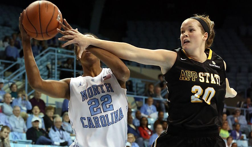 Appalachian State's Katie Mallow (20) defends against a shot by North Carolina's N'Dea Bryant (22) during an NCAA college basketball game in Chapel Hill, N.C., Sunday, Dec. 14, 2014. (AP Photo/Ted Richardson)