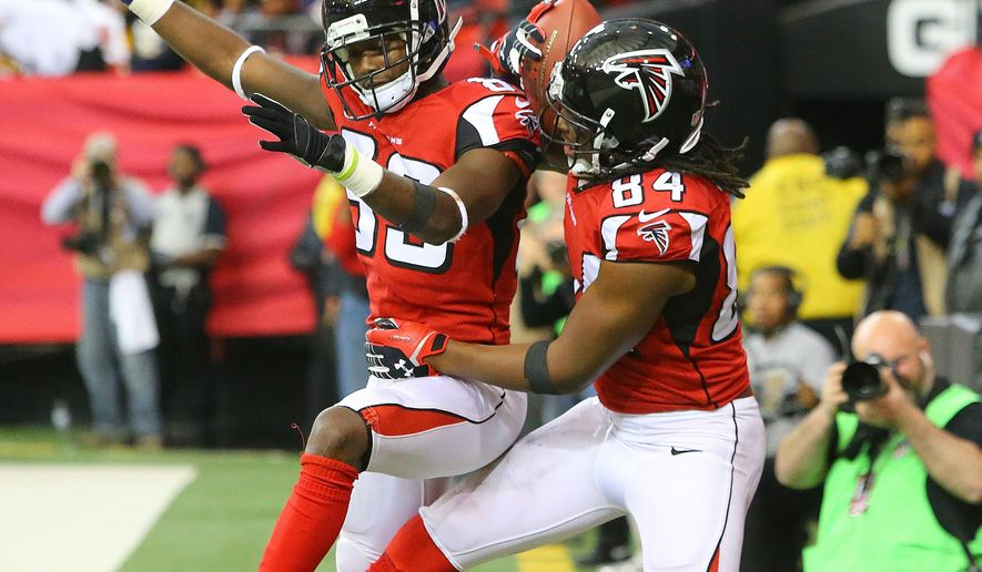Atlanta Falcons wide receiver Roddy White, right, celebrates with Harry Douglas after setting the franchise record with his 62nd touchdown reception during tyhe NFL football game against the Pittsburgh  Steelers  on Sunday, Dec. 14, 2014, in Atlanta.  (AP PHOTO/ATLANTA JOURNAL-CONSTITUTION, Curtis Compton)  MARIETTA DAILY OUT; GWINNETT DAILY POST OUT; LOCAL TELEVISION OUT; WXIA-TV OUT; WGCL-TV OUT  MBI  (REV-SHARE