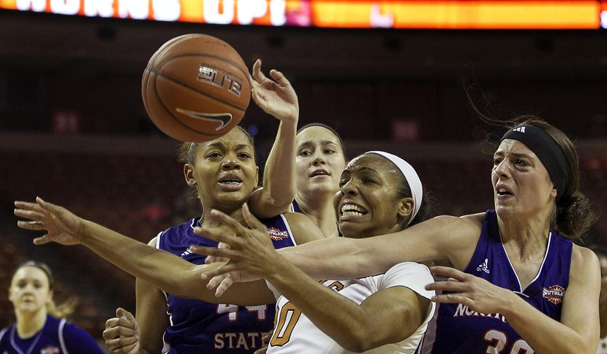 Texas' Brianna Taylor (20), center, scrambles for a loose ball against, from left to right, Northwestern State's Tia Youngblood, Amy Staha and Beatrice Attura during the first half of an NCAA college basketball game Sunday, Dec. 14, 2014, in Austin, Texas. (AP Photo/Rodolfo Gonzalez)