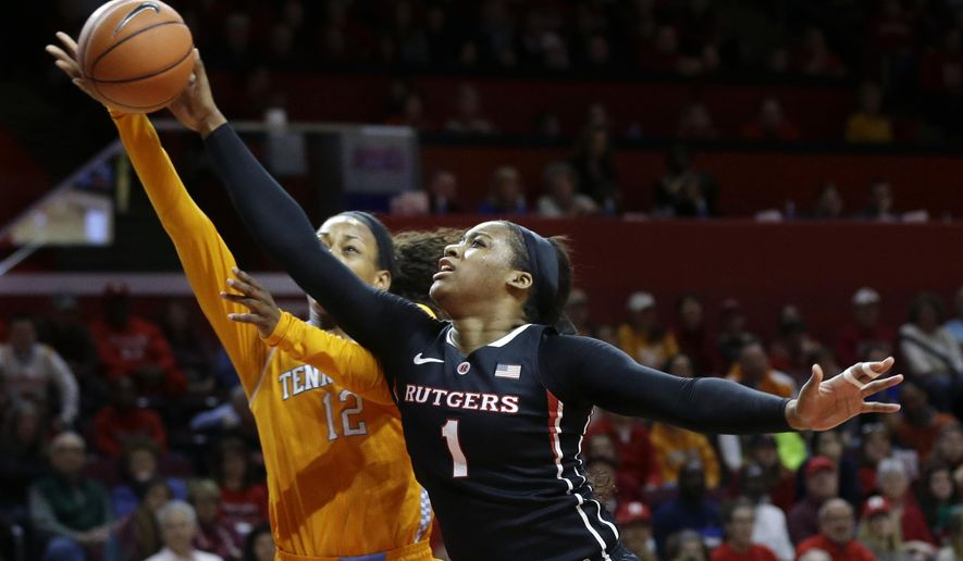 Rutgers' Rachel Hollivay (1) blocks s a shot by Tennessee's Bashaara Graves (12) during the first half of an NCAA college basketball game Sunday, Dec. 14, 2014, in Piscataway, N.J. ((AP Photo/Mel Evans)