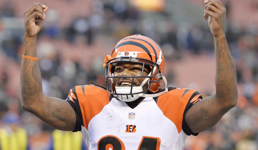 "Cincinnati Bengals cornerback Adam Jones makes the Johnny Manziel ""money"" sign after the Bengals defeated the Cleveland Browns 30-0 in an NFL football game Sunday, Dec. 14, 2014, in Cleveland. (AP Photo/David Richard)"