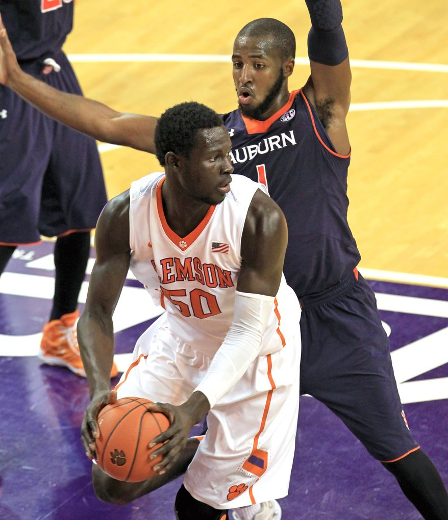Clemson's Sidy Djitte, left, grabs a rebound in front of Auburn's K.T. Harrell,  in the second half of their NCAA college basketball game on Sunday, Dec. 14, 2014 in Clemson, S.C. (AP Photo/Anderson Independent-Mail, Mark Crammer) THE GREENVILLE NEWS OUT, SENECA NEWS OUT