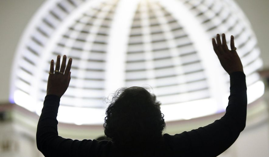 """Attending religious services regularly is associated with being """"very happy,"""" says a new study from the Austin Institute for the Study of Family and Culture in Texas. (AP Photo/The Muskegon Chronicle, Tommy Martino)"""