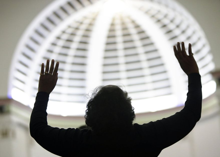 "Attending religious services regularly is associated with being ""very happy,"" says a new study from the Austin Institute for the Study of Family and Culture in Texas. (AP Photo/The Muskegon Chronicle, Tommy Martino)"