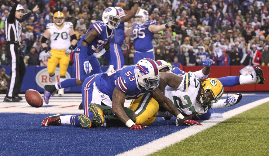 Green Bay Packers running back Eddie Lacy (27) is tackled by Buffalo Bills' Nigel Bradham (53) in the end zone for a safety during the second half of an NFL football game Sunday, Dec. 14, 2014, in Orchard Park, N.Y. The Bills won the game 21-13. (AP Photo/Gary Wiepert)