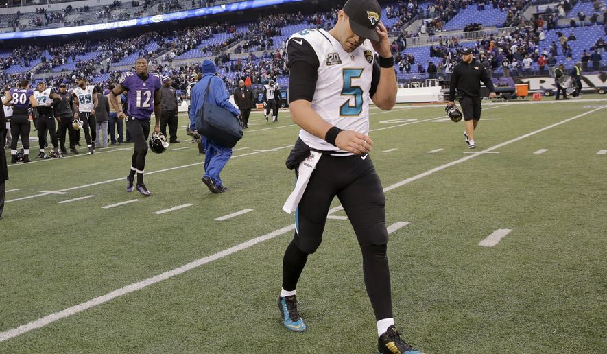 Jacksonville Jaguars quarterback Blake Bortles (5) walks off the field after an NFL football game against the Baltimore Ravens in Baltimore, Sunday, Dec. 14, 2014. The Ravens defeated the Jaguars 20-12. (AP Photo/Patrick Semansky)