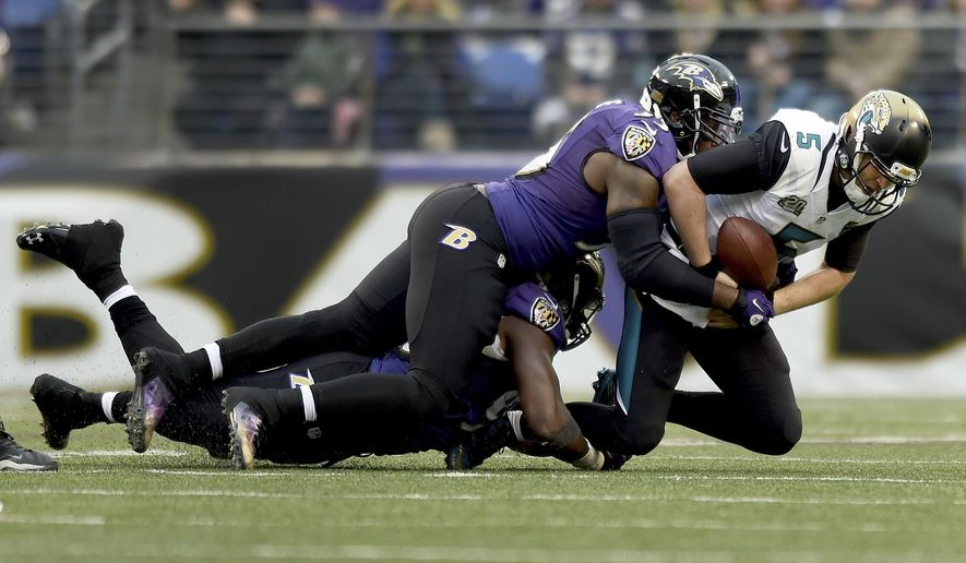 Jacksonville Jaguars quarterback Blake Bortles (5) is sacked by Baltimore Ravens outside linebacker Terrell Suggs (55) during the second half of an NFL football game in Baltimore, Sunday, Dec. 14, 2014. The Ravens defeated the Jaguars 20-12. (AP Photo/Gail Burton)
