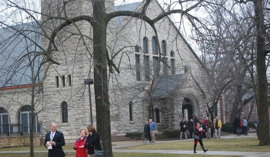Guests file out of Beloit College's Eaton Chapel on Sunday, Dec. 14, 2014, following a remembrance service for Luke Somers. The 33-year-old photojournalist and Beloit College graduate was killed in Yemen on Dec. 6. (AP Photo/The Beloit Daily News, Hillary Gavan)
