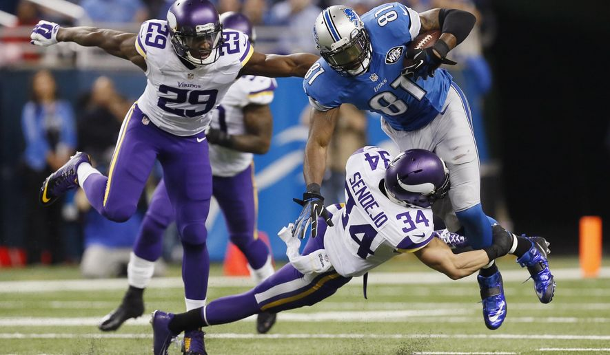 Detroit Lions wide receiver Calvin Johnson (81) is tackled by Minnesota Vikings free safety Andrew Sendejo (34) as cornerback Xavier Rhodes (29) closes in during the second half of an NFL football game at Ford Field in Detroit, Sunday, Dec. 14, 2014. (AP Photo/Paul Sancya)