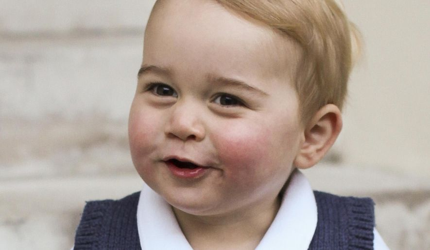 In this photo provided by The Duke and Duchess of Cambridge and taken in late Nov. 2014, Britain's Prince George poses for a photograph in a courtyard at Kensington Palace, London.  Great-grandchild to Britain's Queen Elizabeth II,  Prince George was born July 22, 2013, the son of Prince William Duke of Cambridge, and Catherine Duchess of Cambridge, and is third in line to the British throne. (Associated Press/TRH The Duke and Duchess of Cambridge)