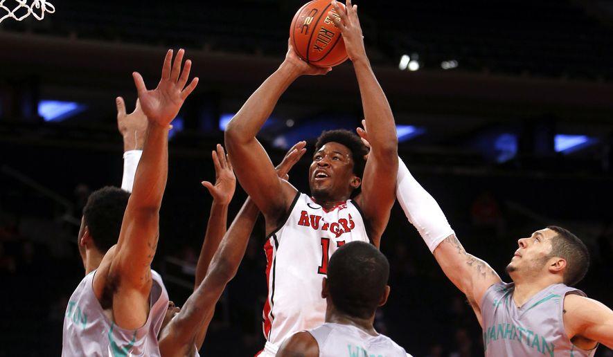 Rutgers' Kadeem Jack (11) shoots against Manhattan during the first half of an NCAA college basketball game Sunday, Dec. 14, 2014, in New York. (AP Photo/Jason DeCrow)