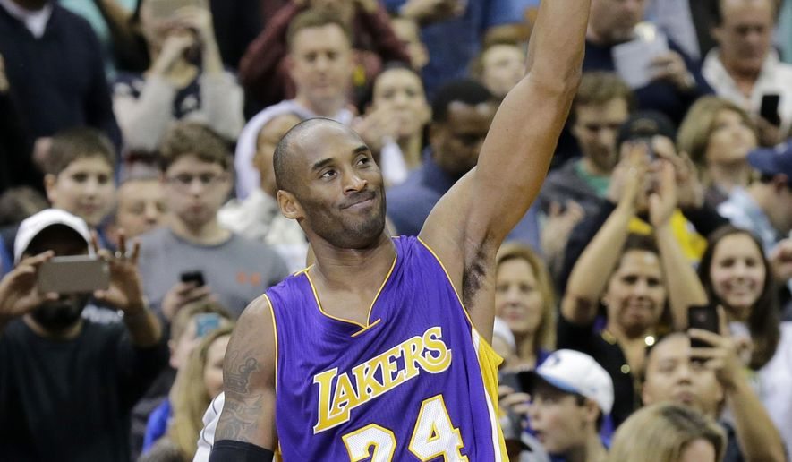 Los Angeles Lakers guard Kobe Bryant (24) holds up the ball and acknowledges the crowd during the second quarter of an NBA basketball game against the Minnesota Timberwolves after passing Michael Jordan on the NBA all-time scoring list in Minneapolis, Sunday, Dec. 14, 2014. (AP Photo/Ann Heisenfelt)