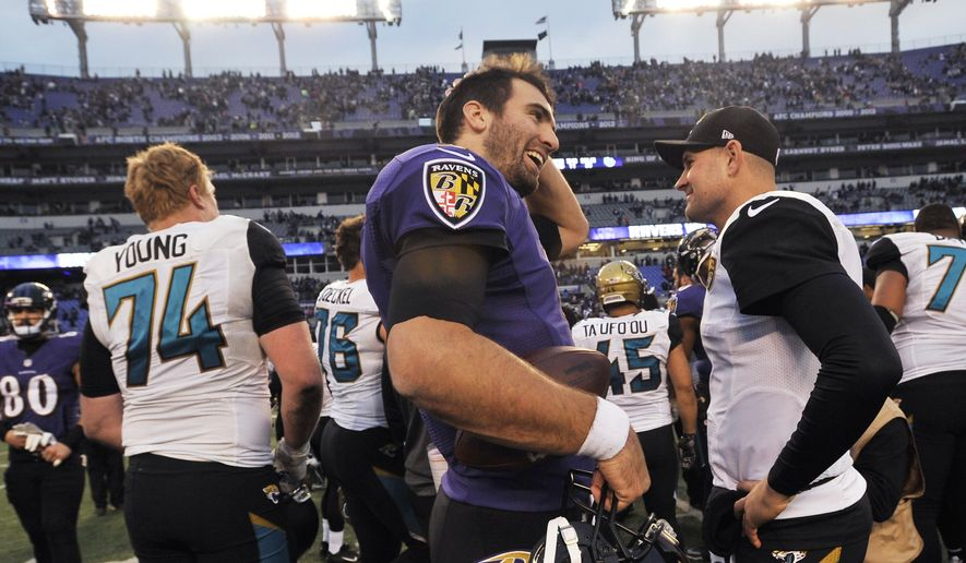 Baltimore Ravens quarterback Joe Flacco (5) smiles as he walks off the field after an NFL football game against the Jacksonville Jaguars in Baltimore, Sunday, Dec. 14, 2014. The Ravens defeated the Jaguars 20-12. (AP Photo/Gail Burton)