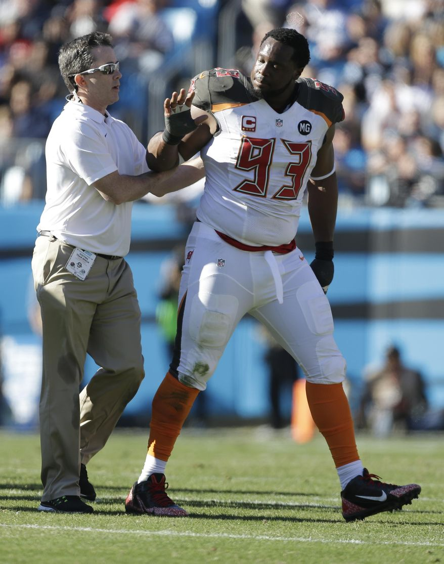 Tampa Bay Buccaneers' Gerald McCoy (93) walks off the field after being injured against the Carolina Panthers in the first half of an NFL football game in Charlotte, N.C., Sunday, Dec. 14, 2014. (AP Photo/Bob Leverone)