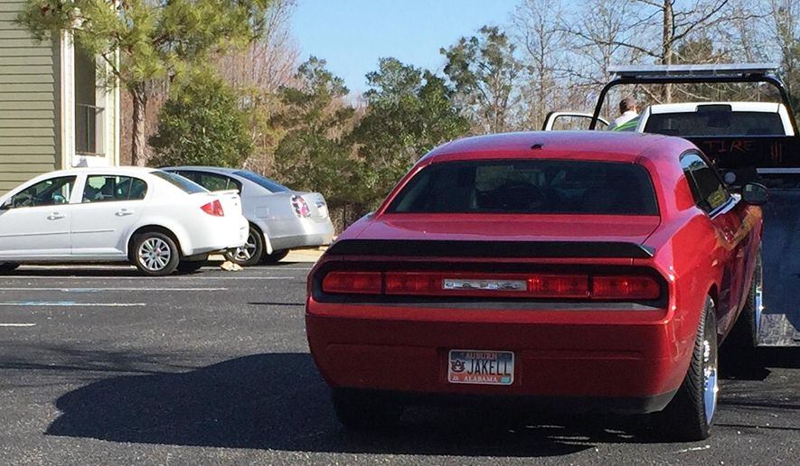 A car with a license plate bearing the name of Auburn football player Jakell Lenard Mitchell is towed from the Tiger Lodge apartment complex in Auburn, Ala., where Mitchell was fatally shot early Sunday, Dec. 14, 2014. Auburn Police Capt. Will Matthews said police answered a call at 12:25 a.m. of shots fired at the apartment complex, where the 18-year-old freshman player was found. Mitchell was later pronounced dead at a hospital, he told The Associated Press. (AP Photo/Kim Chandler)