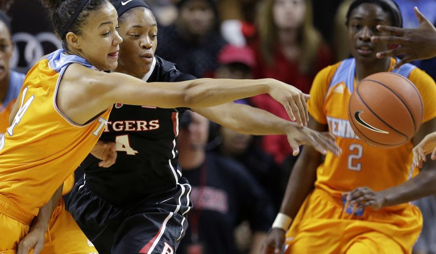 Tennessee's Andraya Carter (14) grabs for a loose ball with Rutgers' Briyona Canty (4) during the second half of a women's NCAA college basketball game Sunday, Dec.14, 2014, in Piscataway, N.J. Tennessee won 55-45. (AP Photo/Mel Evans)